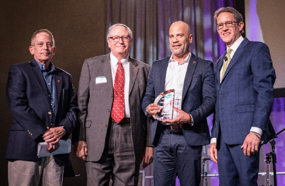 Travelers' leadership team receives an award statue for the Company's work in disability hiring