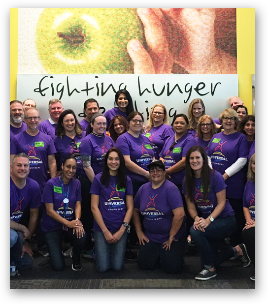 Group of Universal Creative Team Members volunteering to help fight hunger in the local community