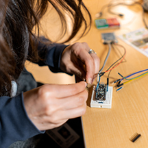 Team Member at desk working on small circuit board