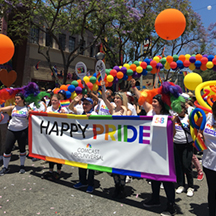Individuals from Out Team Member Resource Group at Universal Studios Hollywood celebrate Pride Month