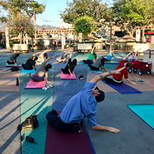 Universal Studios Hollywood Team Members take time to relax and stretch on their yoga mats