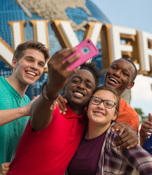 Happy group of diverse young people having fun and taking a selfie