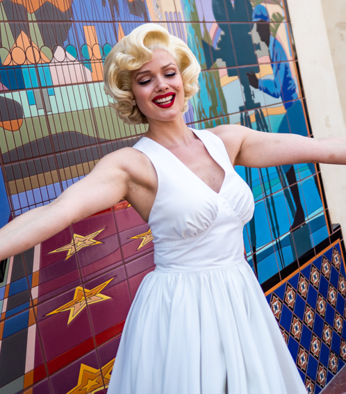 Costumed actress portrays the likeness of Marilyn Monroe from the movie The Seven Year Itch