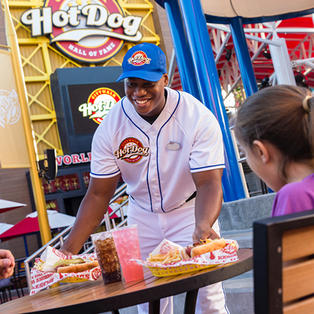 Team Member in baseball uniform working at the Hot Dog Hall of Fame