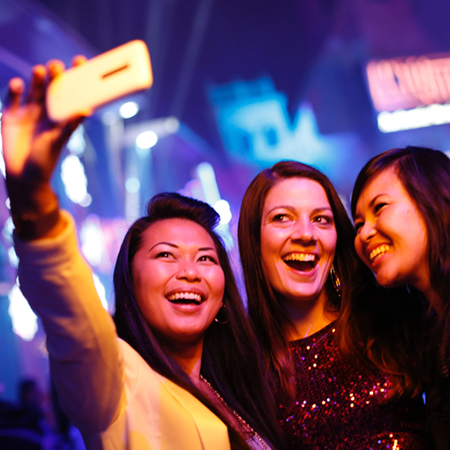 Three women taking a selfie while have a night of fun at Universal CityWalk Orlando