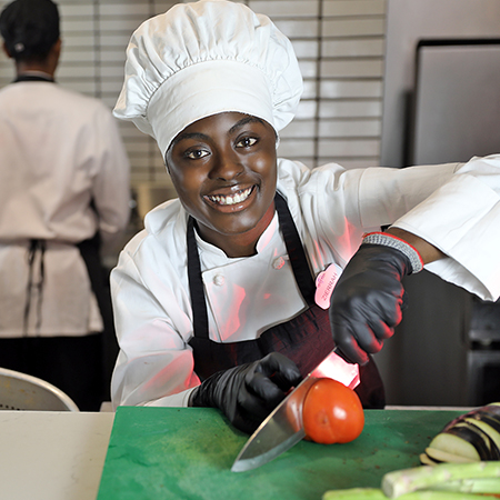 Culinary Team Member prepping vegetables