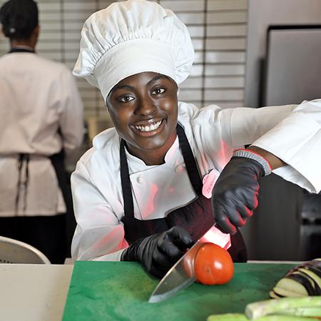 Culinary Team Member prepping vegetables