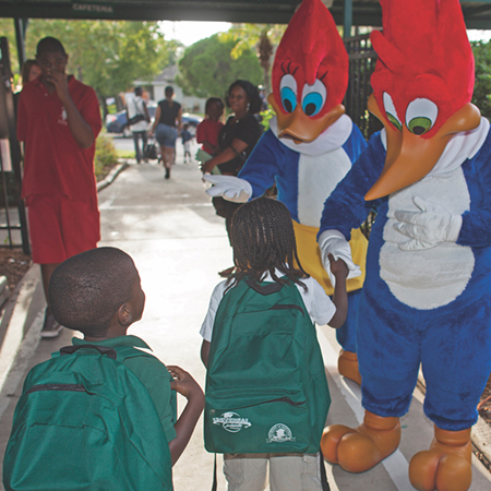Children interact with Team Members dressed as Woody the Woodpecker and his girlfriend Winnie