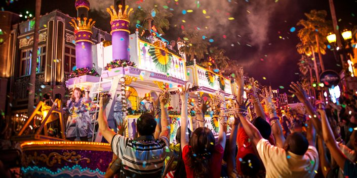 Mardi Gras-themed parade float with cheering crowd