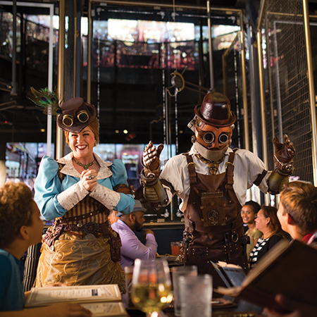 Steampunk-attired Team Members at the Toothsome Chocolate Emporium & Savory Feast Kitchen.