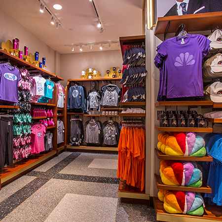 Colorful souvenir merchandise neatly arranged inside the Universal Studios store