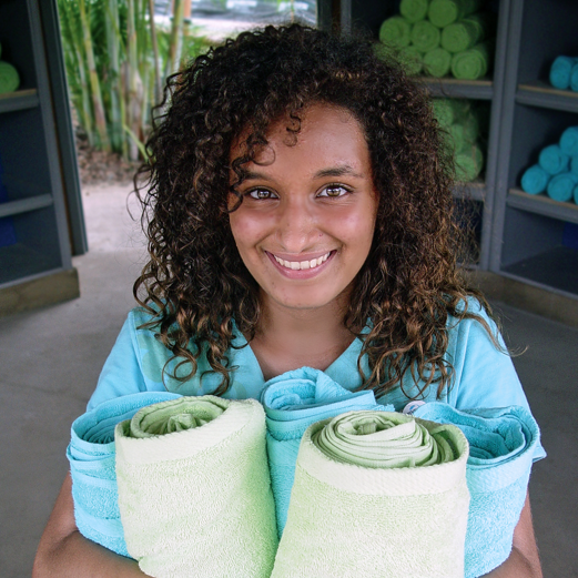 Volcano Bay Team Member provides towels for guests