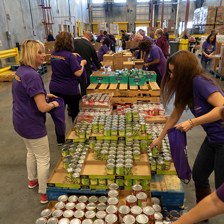Team Members volunteer by sorting canned goods for food bank donations.