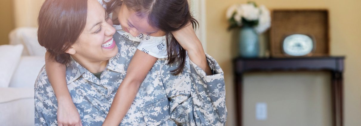 Little girl gives army mom a big hug