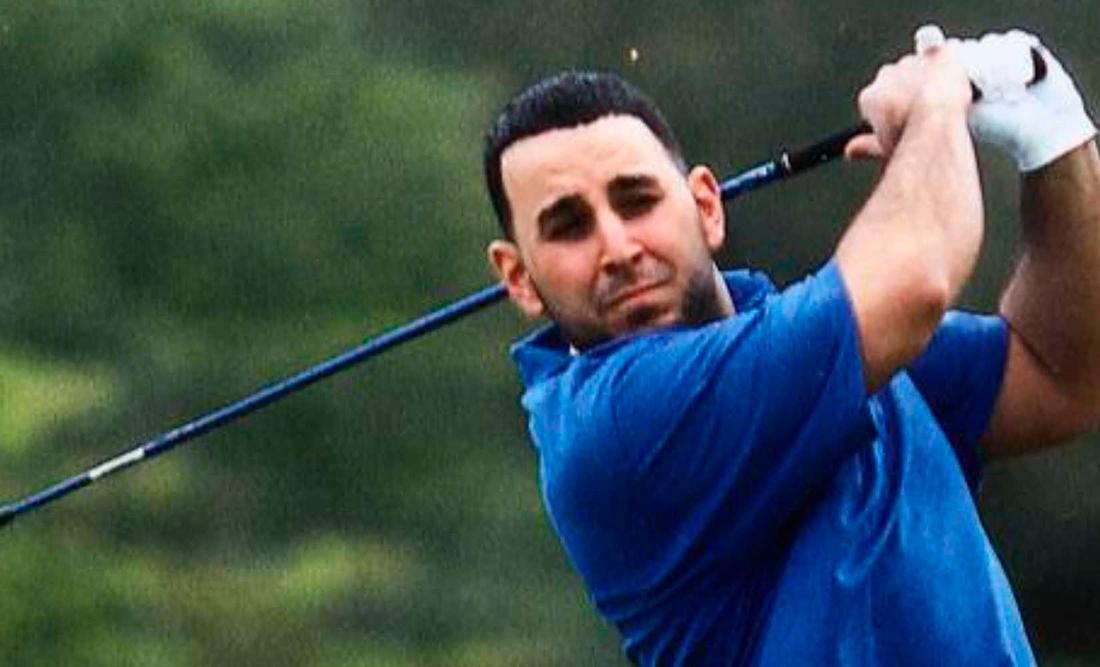 Khalil Al-Amir swinging a golf club