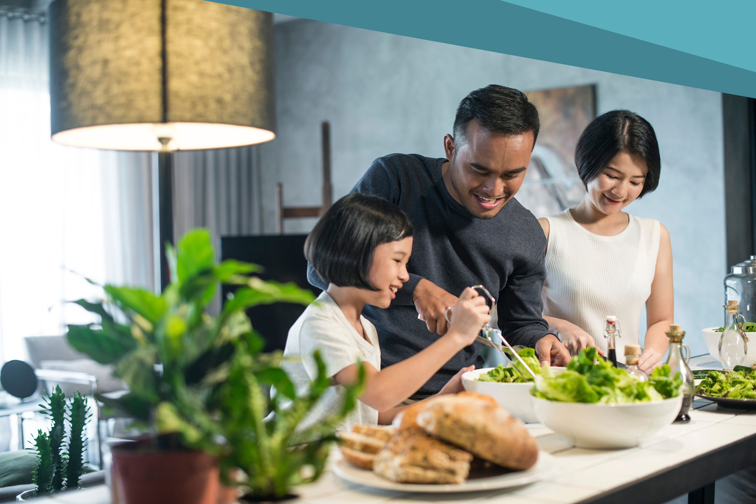 Happy family preparing food in the kitchen.