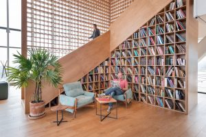 Man sitting in library area of WeWork space