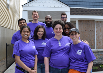 ADP volunteers wearing their signature purple t-shirts
