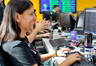 Female ADP tech employee in an open workspace