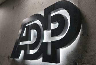 Backlit ADP sign on a wall