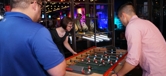 ADP employees in Chelsea playing foosball