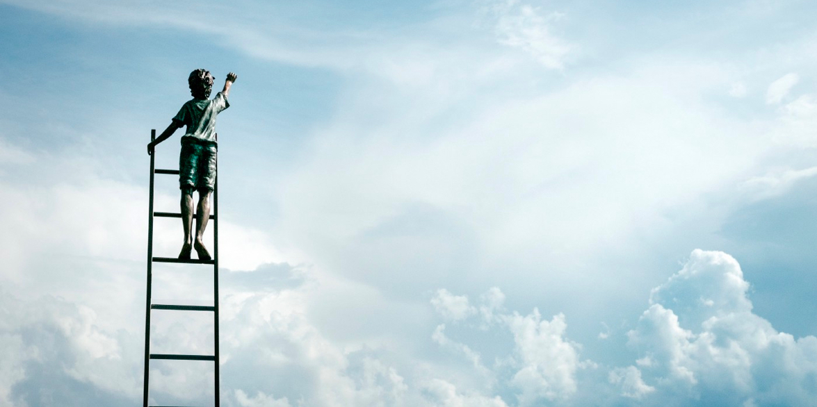 Person on ladder reaching up into the clouds