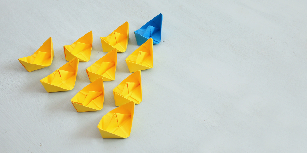 Paper boats in a triangular pattern