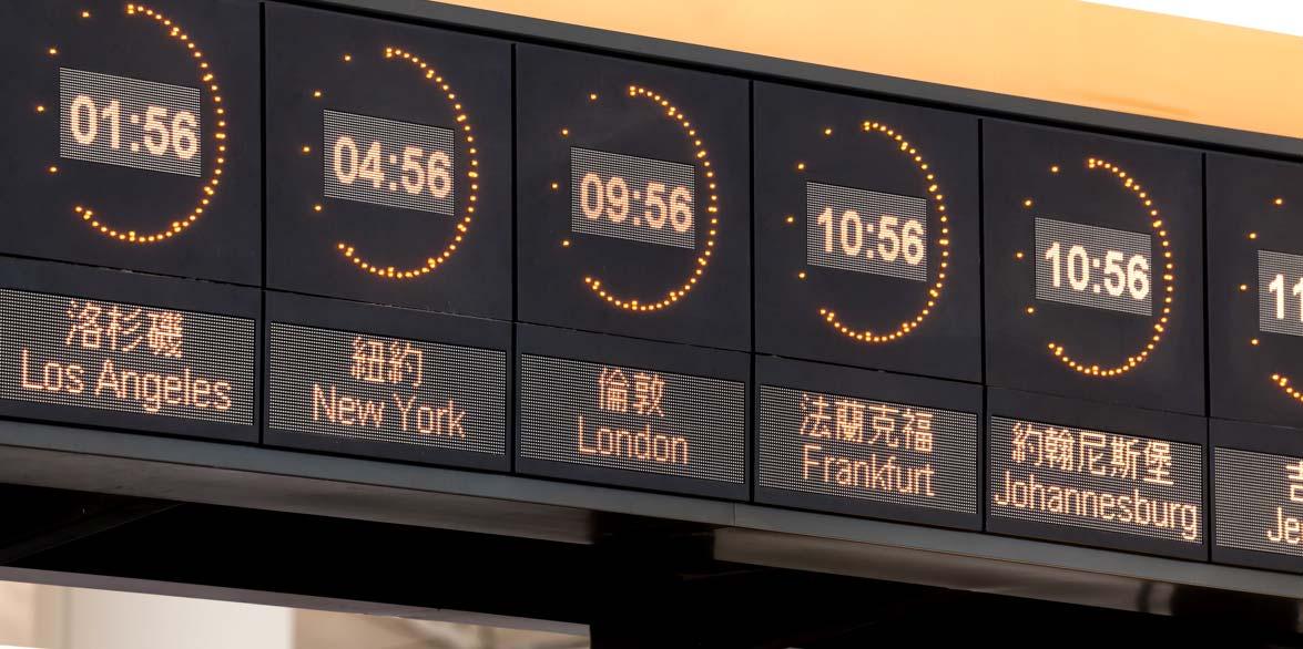 digital clocks display times in Los Angeles, New York, London, Frankfurt, and Johannesburg
