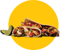 Sizzling fajitas in tortillas