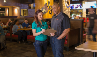 Chili's Manager mentoring a Team Member within a Chili's restaurant