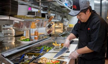 Chili's cook in Chili's kitchen preparing a delicious Chili's entrée