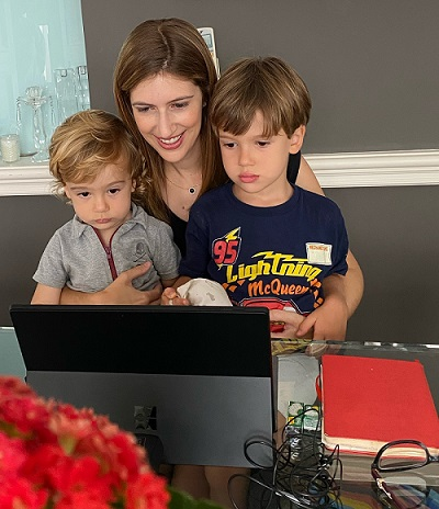 Karina on a virtual meeting with her two children