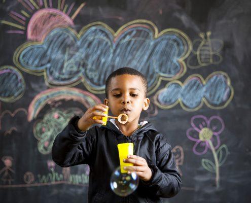 child-blowing-bubbles