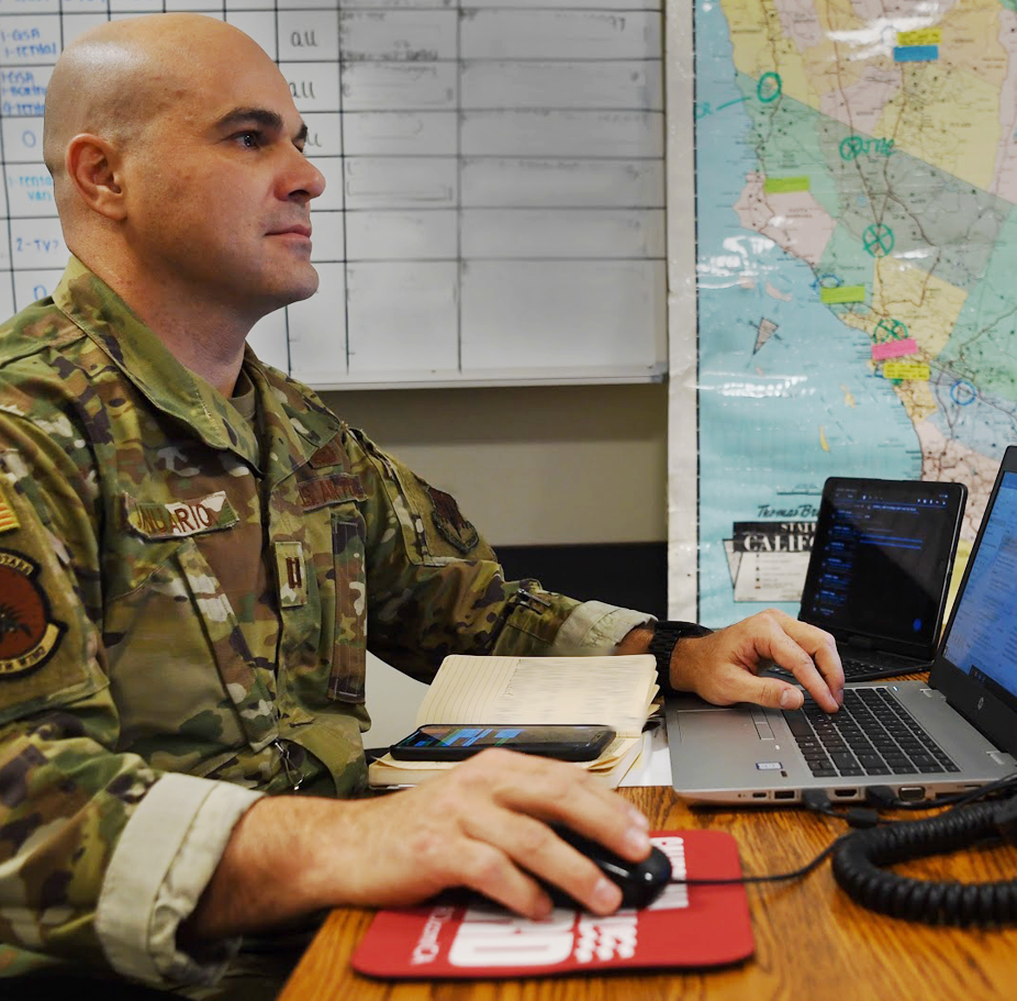 Man in uniform at computer