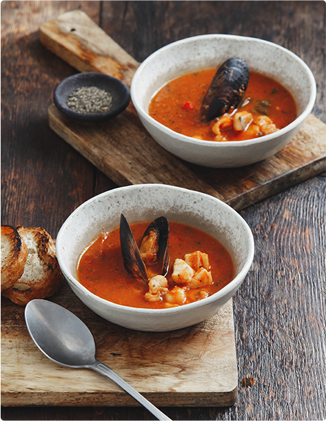 Two bowls of Manhattan clam chowder soup