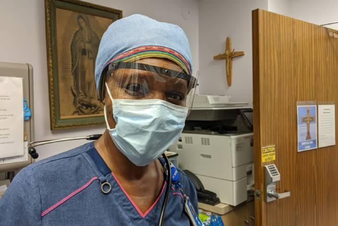 A nurse wearing PPE.