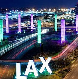 Long exposure, night time photo of traffic around Los Angeles International Airport