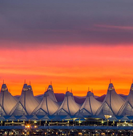 Panoramic photo of Denver International Airport's tent-like structures at sunset