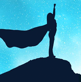 Silhouette of person against starry background striking superhero pose with flowing cape