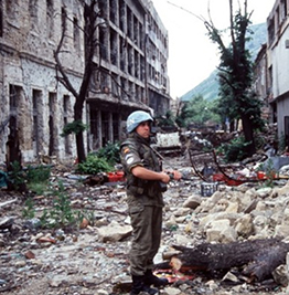 Soldier patrolling war-torn street