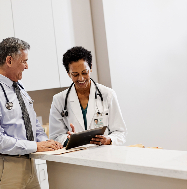 Two doctors reviewing a medical chart together.