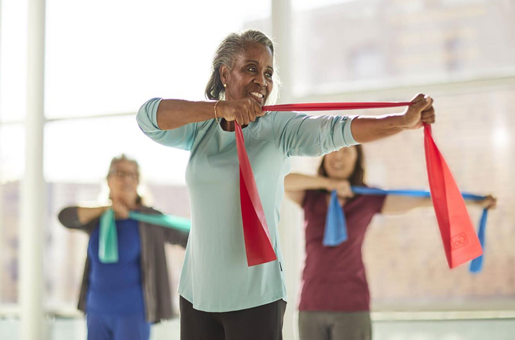 An older woman participating in an exercise class.