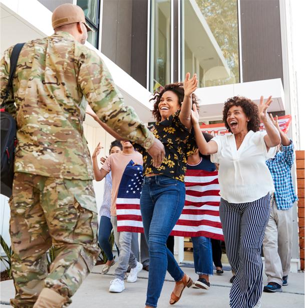 Military member greeting family