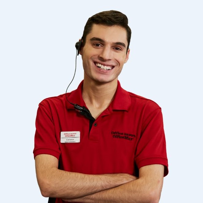 a retail associate wearing a red Office Depot/Office max polo shirt