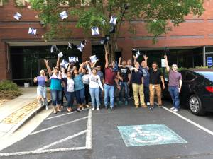 A group of college graduates throwing their graduation caps in the air