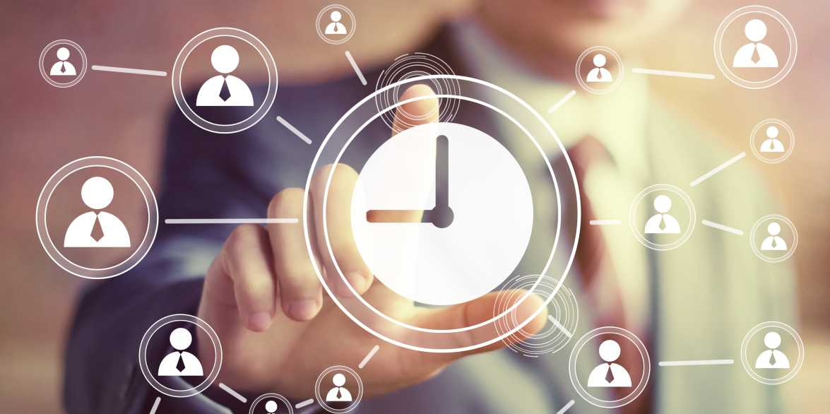 Businessman hand presses web clock time sign button