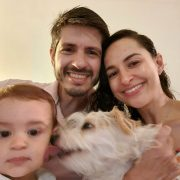 Family portrait of Roberto, his wife and child, and dog.