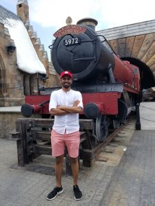 Sanjay in front of the Harry Potter Train