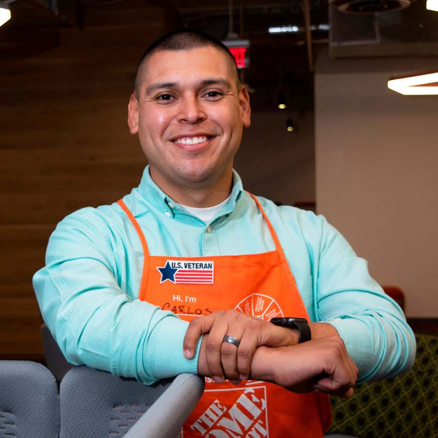 Man in Home Depot apron smiling at camera