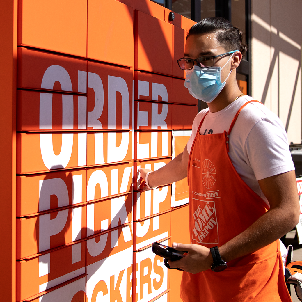 Man working at order pickup in a mask